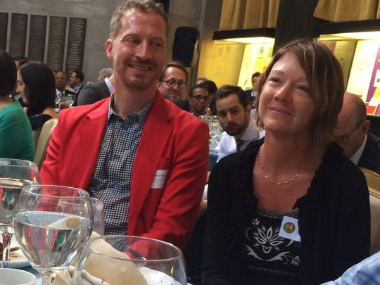 The Register's Andie Dominick, winner of the 2018 Pulitzer Prize for editorial writing (right), sits with fiction prize winner Andrew Sean Greer Wednesday, May 30, 2018 at the Pulitzer Prize luncheon in New York.