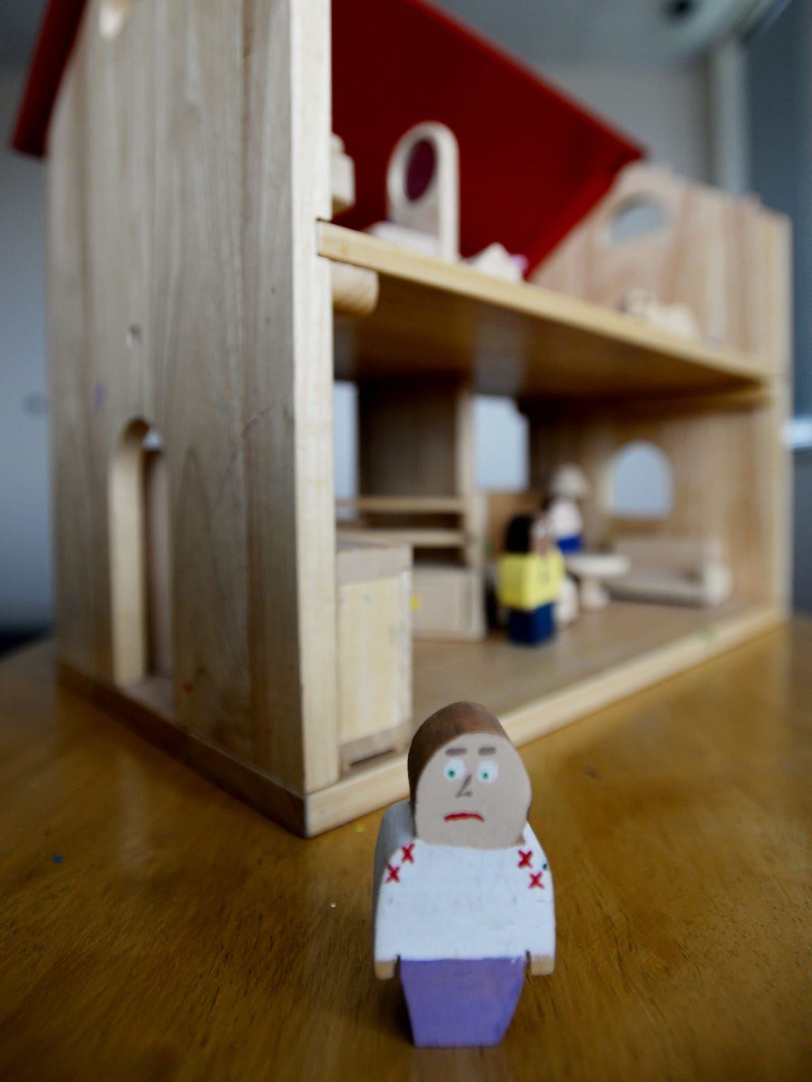 A dollhouse is used in therapy at the Gingerbread House.