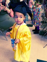 A 2015 Early Steps graduate in cap and gown