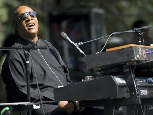 Musician Stevie Wonder performs during a free pop-up concert Monday on the D.C. Armory Mall, in Washington, D.C.