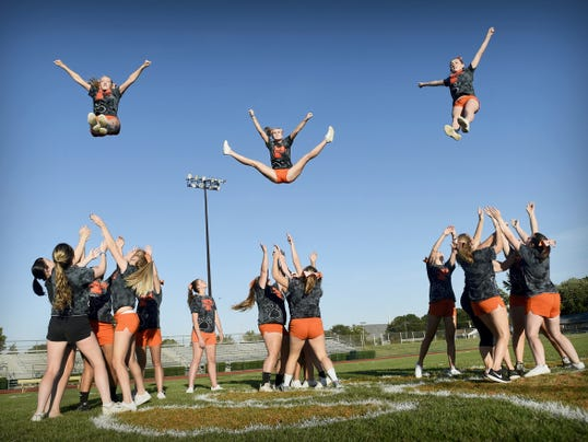 Palmyra Area High School cheerleaders Megan Martin, Taylor Eckenrode and Desiree Brown are launched into the air by the varsity squad at the school recently. After placing first overall at the UCA cheer camp at Pine Forest this summer, the squad was invited to cheer at the Citrus Bowl on Jan. 1 in Orlando, Fla.