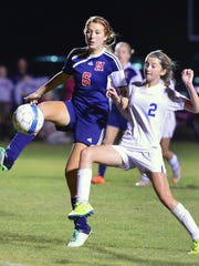 White House High freshman midfielder Shelby Deering (2) battles for possession with White House Heritage junior Sky Baker.