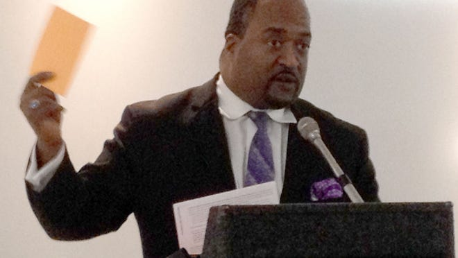 Erik Saunders, the lead community organizer of the Restaurant Opportunities Centers of Michigan, talks Wednesday, Oct. 22, 2014, at Colors restaurant in Detroit about a study that found segregation and inequality for workers of color and women in the restaurant industry.