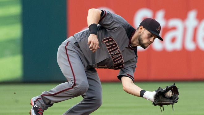 Jun 16, 2017; Philadelphia, PA, USA; Arizona Diamondbacks shortstop Chris Owings (16) fields a ground ball for an out against the Philadelphia Phillies during the second inning at Citizens Bank Park. Mandatory Credit: Bill Streicher-USA TODAY Sports