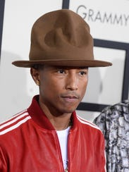 Pharrell Williams wears a Vivienne Westwood Canadian