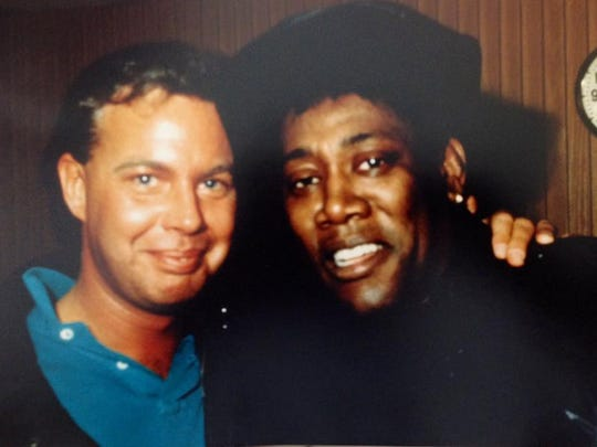 Robert Higgins with the late Clarence Clemons.
