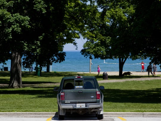 A car is seen parked Tuesday, June 16, 2015 at Lakeside Park in Port Huron. Effective July 1, city residents will be charged $5 for an annual pass, county residents will be charged $5 per visit, and out-of-county residents will be charged $10 per visit.