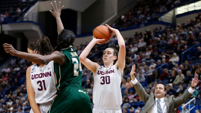 Connecticut forward Breanna Stewart (30) shoots the ball as South Florida forward Alisia Jenkins (24) defends in the first half at XL Center.