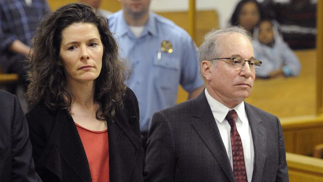 Paul Simon, right, and his wife, Edie Brickell, make a brief appearance in Superior Court in Norwalk, Conn., May 16, 2014, for a disorderly conduct case about an April 26, 2014, argument inside a cottage on their New Canaan property. The couple had been scheduled to return to court Tuesday, June 17, 2014, but prosecutors declined to pursue the case. The charges will be dropped and eventually erased after 13 months. (AP Photo/New York Post, Douglas Healey, Pool, File)
