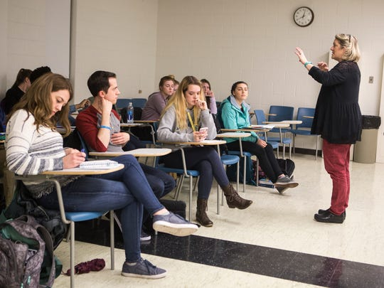 University of Delaware Healthcare Theatre Program co-founder AmyÊCowperthwait, right, works with students during class Thursday at the UD campus.