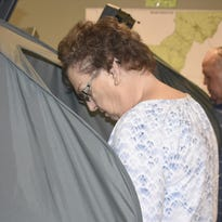 Audrey Allen of Ashland City cast her ballot during early voting at the Cheatham County Election Commission. In the background is her husband, Joseph. Early voting for the Aug. 4 election will continue through July 30.