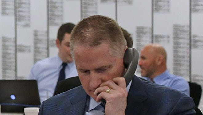 Russ Ball works the phones during the 2016 NFL Draft at Lambeau Field in Green Bay.