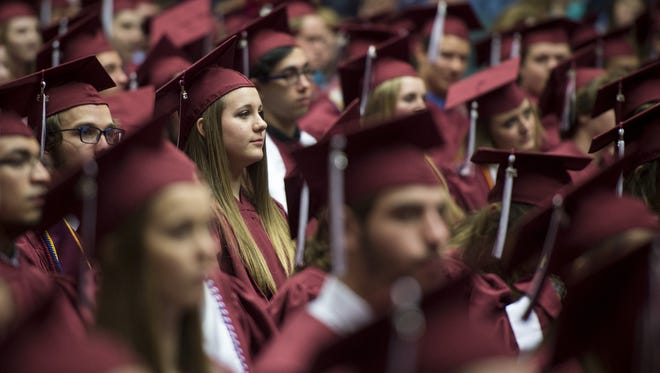 Graduates line up to receive their diplomas during Franklin High School's graduation ceremony at Lipscomb University's Allen Arena, Saturday, May 21, 2016, in Nashville, Tenn.