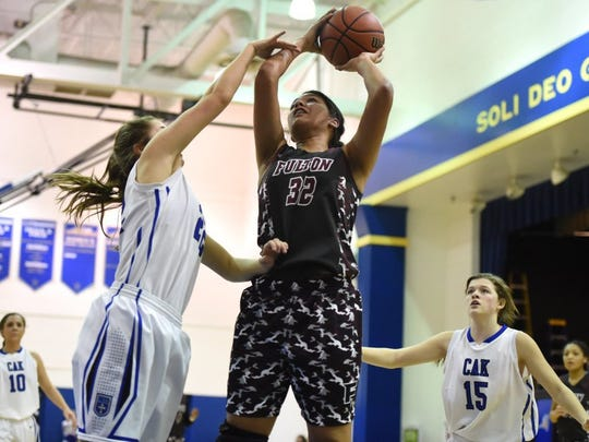 Fulton's Janae Fuqua (32) shoots as CAK's Bethany Meadows (22) defends during a high school basketball game at Christian Academy of Knoxville in Knoxville on Friday, Feb. 26, 2016.