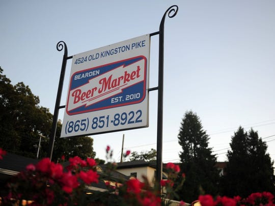 A sign marking Bearden Beer Market stands outside the establishment, located off Kingston Pike, on Tuesday, June 7, 2016.