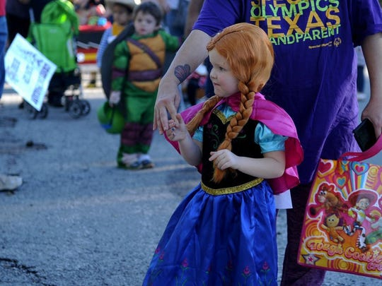 Lauren Roberts/Times Record News Sora Trotter, dressed as Princess Anna of Arendelle, shows off to the judges in the costume contest Saturday, Oct. 22, 2016, at the Wichita Falls Parks & Recreation Department's A Lucy Park Halloween.
