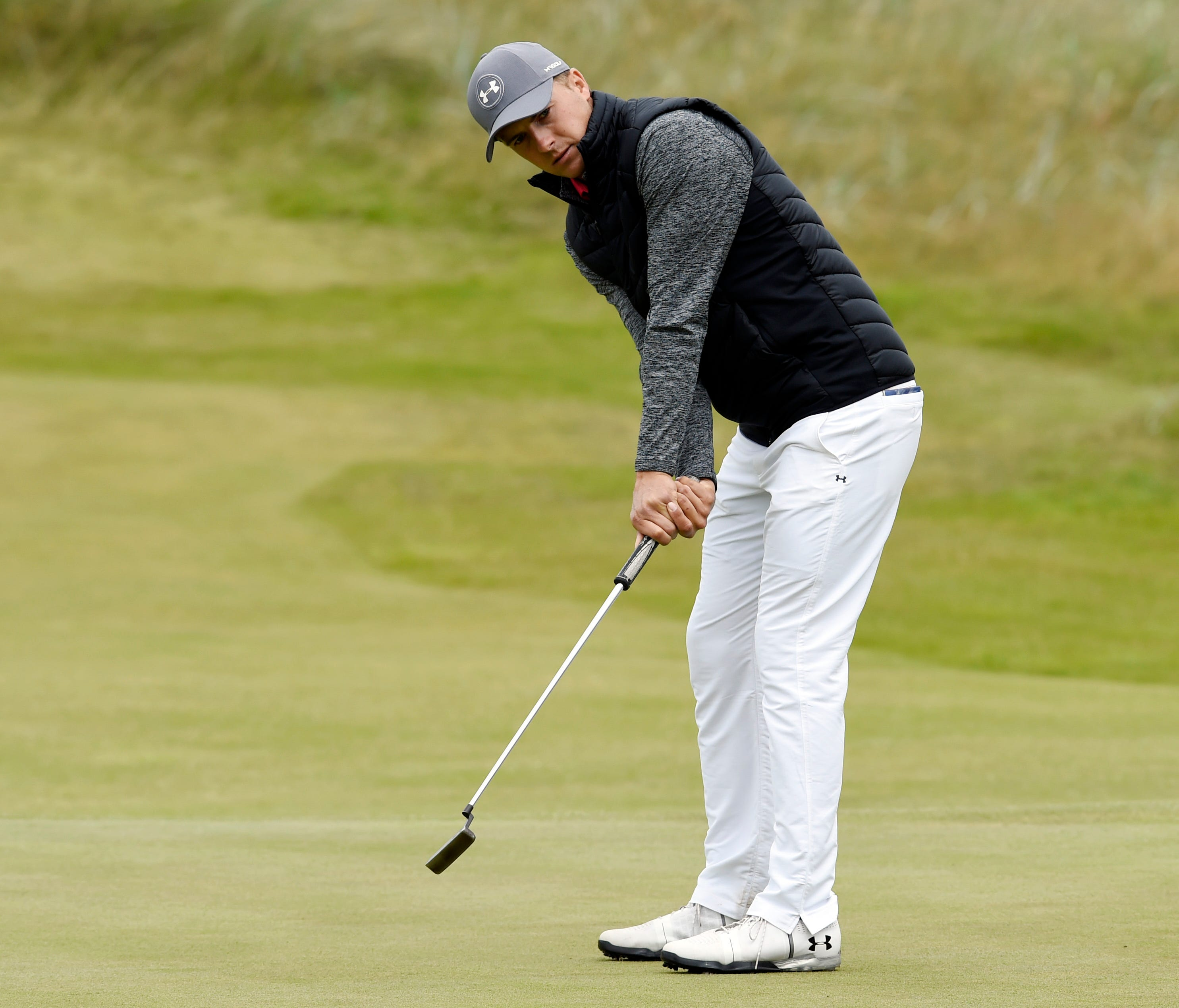 Jordan Spieth reacts to his putt on the 14th hole during the first round of The 146th Open Championship golf tournament at Royal Birkdale Golf Club.