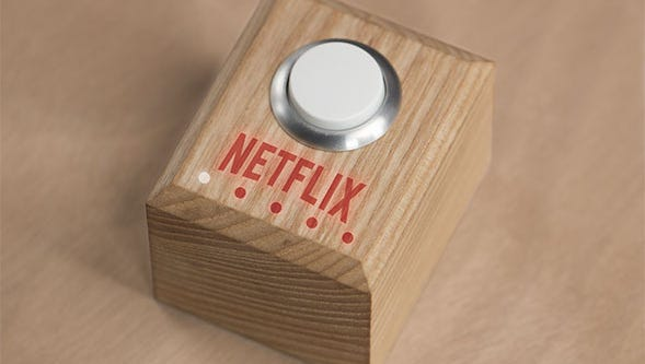 Yes, this is a real Netflix button. One press dims the lights and starts the app.