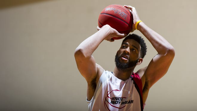 FILE -- Indiana alumni Christian Watford (2) works from the free throw line during the second half of action of the Knox Indy Pro Am Alumni game Saturday, July 26, 2014, at IUPUI. The game featured former players from Indiana and Purdue universities. Indiana University defeated Purdue University 116-113.