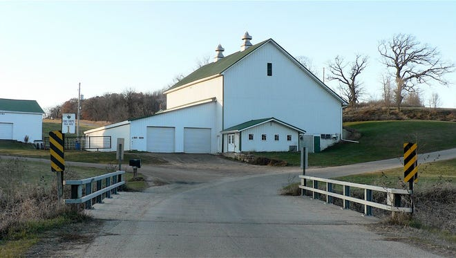 The empty dairy barn today. Note the additions. Hefty Creek is in the foreground.