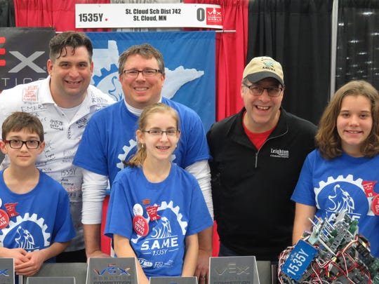 S.A.M.E. team members and coaches Morgan Zieglmeier, left, Andy Zieglmeier, Jeremy Reisinger, Ava Reisinger, Bob Leighton and Emma Leighton pose during the VEX Worlds robotics event in Louisville, Kentucky. The largest robotics competition ever took place April 20-23.