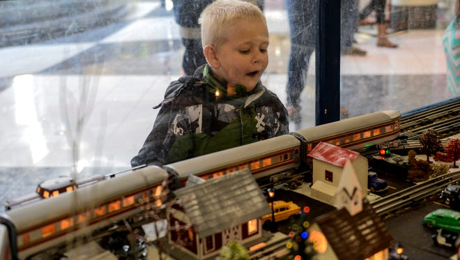 Danny Snader, 5, of Jonestown, reacts to one of the trains in St. Mark Lutheran Church's Advent Train Garden set up inside the Lebanon Valley Mall at Boscov's.  The train garden will be raffled to raise money for Operation Santa, a charity that gives food, clothing and toys to disadvantaged Lebanon County residents. The winner will be drawn at 8 p.m. Dec.  23. This is the ninth year that the Annville church has built the train garden.