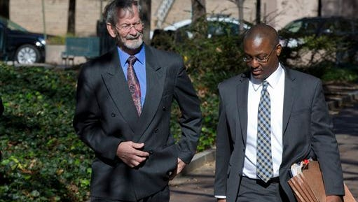 Douglas Hughes, left, who flew a gyrocopter through the National Mall before landing on Capitol Hill, left, arrives with his public defender Tony Miles, for a plea hearing at the federal courthouse in Washington, Friday, Nov. 20, 2015.