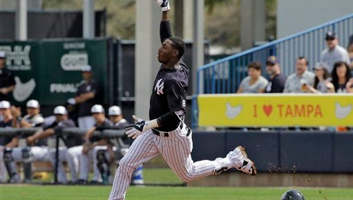 New York Yankees' Jorge Mateo celebrates after hitting a home run off Boston Red Sox starting pitcher Steven Wright during the third inning of a spring training baseball game Saturday, March 5, 2016, in Tampa, Fla.