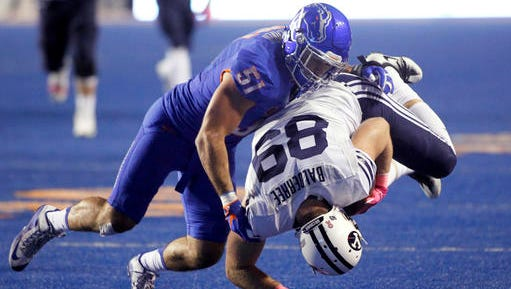 BYU tight end Tanner Balderree is brought down by Boise State linebacker Ben Weaver.