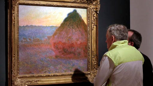 "FILE - In this Nov. 4, 2016, file photo, Claude Monet's ""Grainstack"" is displayed at Christie's, in New York. The 1891 painting being offered Wednesday, Nov. 16, 2016, is one of a few still in private hands."