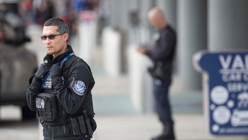 Security personnel stand guard outside Fort Lauderdale–Hollywood International Airport, Friday, Jan. 6, 2017, in Fort Lauderdale, Fla. A gunman opened fire in the baggage claim area at the airport Friday, killing several people and wounding others before being taken into custody in an attack that sent panicked passengers running out of the terminal and onto the tarmac, authorities said.
