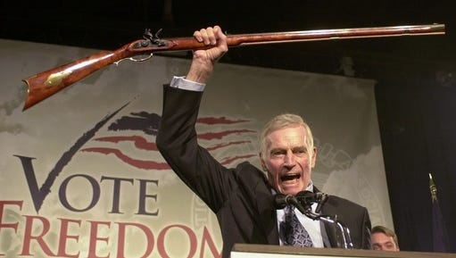 """FILE - In this Oct. 21, 2002 file photo, National Rifle Association President Charlton Heston holds up a rifle as he addresses gun owners during a """"get-out-the-vote"""" rally in Manchester, N.H. A Philadelphia judge's clash with the late actor has indirectly led to a U.S. appeals court decision to overturn a 1998 murder conviction. The judge met with the victim's family during the bench trial to discuss a blog they started that noted the """"Ben-Hur"""" actor had called her soft on crime in an NRA speech in Philadelphia. The U.S. appeals court threw out the murder conviction last week, saying the meeting was inappropriate and the defense lawyer ineffective."""