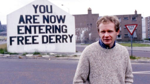 FILE - In this July 1984 file photo Martin McGuinness, Sinn Fein politician and a former Brigade Commander of the IRA poses for a photo in Londonderry, Northern Ireland. McGuinness, the Irish Republican Army commander who led his underground, paramilitary movement toward reconciliation with Britain, and was Northern Ireland's deputy first minister for a decade in a power-sharing government, has died, his Sinn Fein party announced Tuesday, March 21, 2017, on Twitter. He was 66.