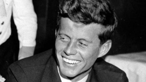 FILE - In this Feb. 9, 1944, file photo, U.S. Navy Lt. John F. Kennedy smiles at the Stork Club in New York. A diary written by Kennedy in 1945 during his brief stint as a journalist after World War II is being auctioned on April 26, 2017, by RR Auction in Boston.