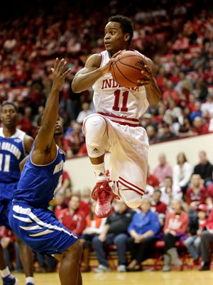 Indiana guard Yogi Ferrell (11) looks to pass under the basket during a NCAA men's basketball game on Monday, Dec. 22, 2014, at Assembly Hall in Bloomington.