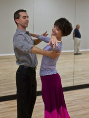 Luciano Catelli, owner of Shore DanceSport in Brick, dances with student Doreen Bender of Brielle.