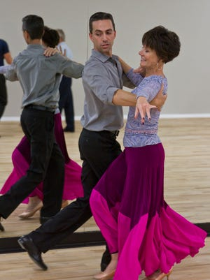 Luciano Catelli, owner of Shore DanceSport, a dance studio in Brick, gives a lesson to Doreen Bender of Brielle.
