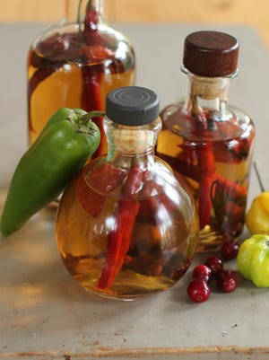 Homemade boozy hot sauce is a breeze to make is a great holiday gift.