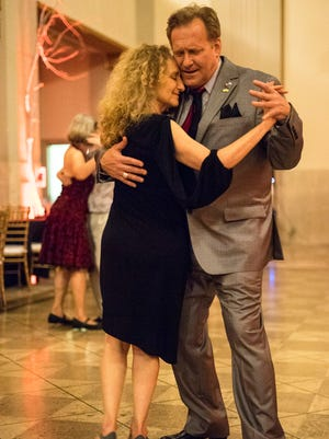 Andy Blair and Deborah Denenfeld feel the moment during the Louisville Tango Festival on Friday night. May 27, 2016.