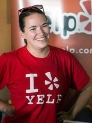 Kathy Van Ryzin of Louisville's Yelp Elite Squad works a booth during a Support Our Troops event at The Post in Germantown on June 20.