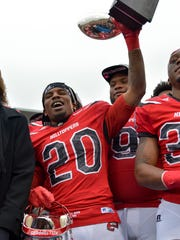 Dec 3, 2016; Bowling Green, KY, USA; Western Kentucky Hilltoppers running back Anthony Wales (20) holds up the MVP trophy following the CUSA championship game against the Louisiana Tech Bulldogs at Houchens Industries-L.T. Smith Stadium. Western Kentucky won 58-44.