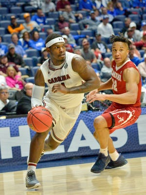 South Carolina Gamecocks guard Rakym Felder (4) drives against Alabama Crimson Tide guard Dazon Ingram (12) during the second half of game eight of the SEC Conference Tournament at Bridgestone Arena. Alabama won 64-53.