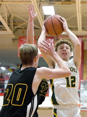 Reynolds' Isaiah Pruett goes up for a shot against Tuscola's Jarred Swanger during the semi-final round of the WMAC tournament at Erwin High School on Wednesday, Feb. 14, 2018.