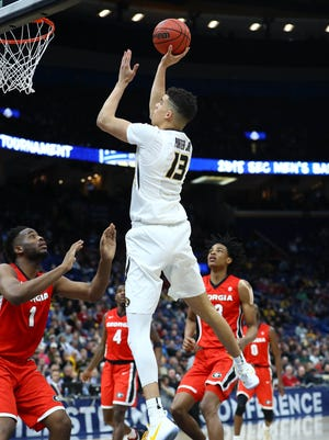 Missouri Tigers forward Michael Porter Jr. (13) goes up for a layup against Georgia Bulldogs forward Yante Maten (1) during the second half of the second round of the SEC Conference Tournament at Scottrade Center.
