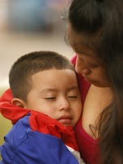 Maria holds her 4-year-old son, Franco, after he arrived at the El Paso International Airport on July 26. The two had been separated for over six weeks after being caught entering the country illegally through Santa Teresa, N.M. Maria was held in an El Paso area detention facility while Franco was in New York City. The two are from Guatemala and plan to travel to Alabama to stay with relatives.