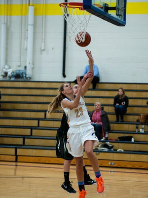 Maggie Gosiger scores in fourth quarter for Seven Hills in their win over New Miami 34-33 Wednesday night.