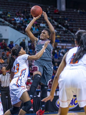 UMES' TeAmber Burke attempts a shot against a Savannah State defender during the MEAC Women's Championship game Saturday.