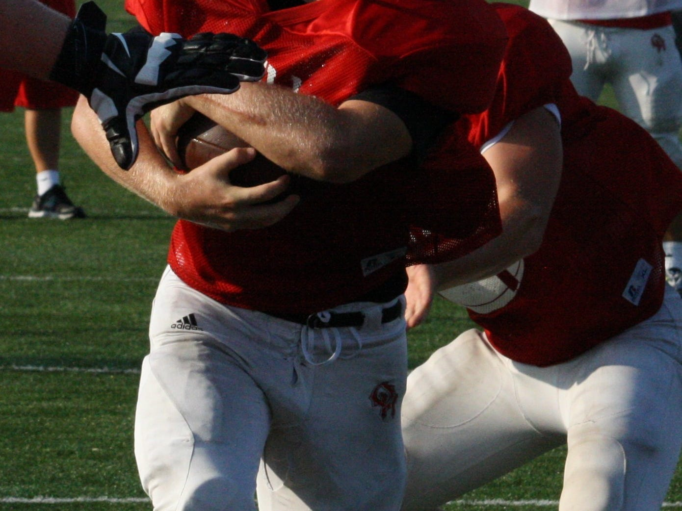 Oak Hills High School senior running back Brock Schubert takes the handoff up the middle during practice Aug. 20 at Oak Hills. Schubert will assume the starting running back duties after only receiving 16 carries in 2013.