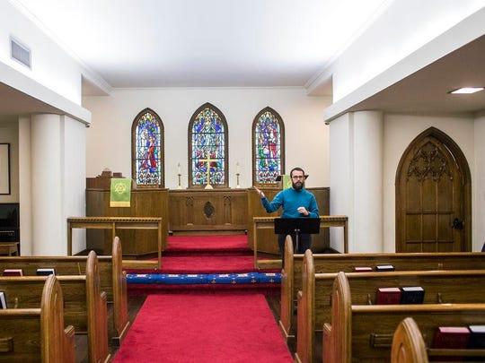 Ben Floyd prays inside the Daybreak community chapel