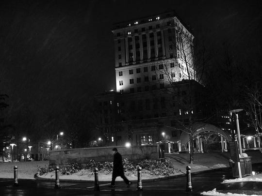 A man walks in downtown Asheville Wednesday night.